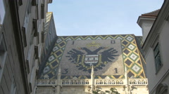 The double-eagle imperial emblem on the roof of Stephansdom, Vienna Stock Footage