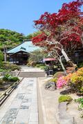 Stock Photo of KAMAKURA, JAPAN-Circa APR, 2013: Stone road to the wooden temple is on the in