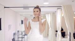 Joyful bride talking on the phone and smile Stock Footage