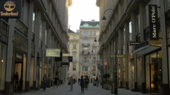 View of shops and people walking on Trattnerhof in Vienna Stock Footage