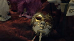 Stock Video Footage of Venetian masks for sale in a souvenir shop in Vienna