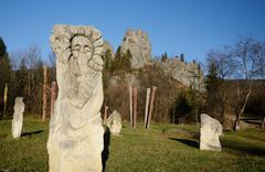 Stock Photo of Ancient idols near ruins of Tustan - rock fortress in Carpathian Mountains