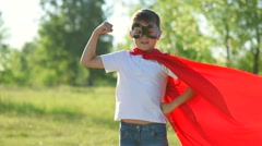 Superhero kid outdoors. Little Boy wearing Super hero costume Arkistovideo