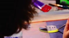 Artist paints a picture with a brush on canvas Stock Footage
