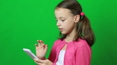 Emotional little girl talking on a smartphone Stock Footage