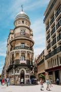 Old beautiful building in the street Fernandez Gonzalez in Sevil Stock Photos