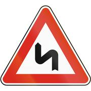 Road sign used in Slovakia - Double bend, first to the left - stock illustration
