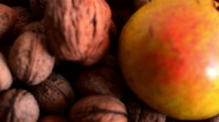 Delicious Pear and Big Walnut on a Brown Background Stock Footage