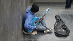 street artist musician: playing acoustic classical guitar in the street - stock footage