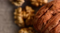 Walnuts with Autumn Leaves on Brown Background Stock Footage