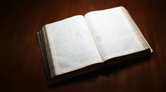 Old Bible open on Table Stock Footage