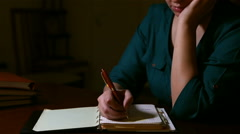 Girl Writing in Notepad Stock Footage