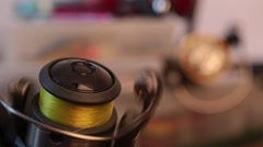 Turning fishing reel on background blur tackles Stock Footage