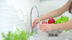 Healthy pregnant woman drinking fresh water in the kitchen Stock Footage