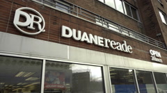 Duane Reade drugstore pharmacy open 24 hours sign 7th Ave Greenwich Village NYC Stock Footage