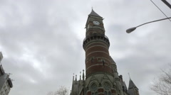Beautiful cathedral clock tower Jefferson Market Library tilting down people NYC Stock Footage