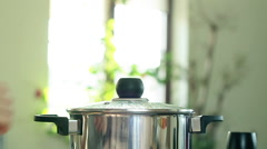 Female hands add parsley into boiling soup in pot, close up, slow motion HD Stock Footage