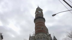 Jefferson Market Library on cloudy fall day cars stopped crosswalk bicycles Stock Footage
