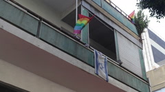 Pride gay flag next to Israel flag on a Tel-Aviv balcony, Israel Stock Footage