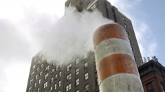Smoke stack steam pipe at construction site panning Lennox Health Hospital NYC Stock Footage