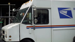 USPS truck driving in slow motion turning corner in Manhattan NYC 1080 HD - stock footage