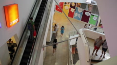 People go up an escalator in Dizengoff Center shopping mall, Tel-Aviv, Israel - stock footage