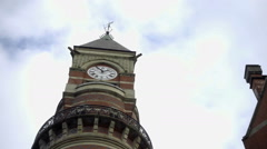 zooming out from clock tower on Jefferson Market Library West Village street NYC - stock footage