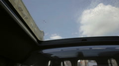 large caravan taxi cab interior tilting down from big sunroof to backseat tv NYC - stock footage
