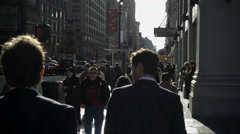 men in business suits walking slow motion day 8th Avenue Manhattan NYC - stock footage