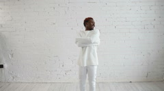 An insane black man in his forties wearing a straitjacket dance and try to get - stock footage