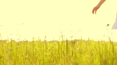 Beauty girl running on yellow wheat field over sunset sky. Freedom concept. Stock Footage