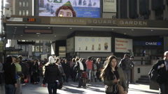 New Yorkers and tourists walking on crowded street outside Madison Square Garden Stock Footage