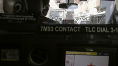 Rising shot taxi cab interior with driver seat and graffiti truck windshield NYC Stock Footage