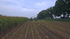 Aerial view of a farmer with a thresher harvesting maize or corn Stock Footage