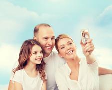 Happy family with camera at home Stock Photos