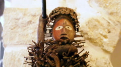 Scary African sculpture doll figure - stock footage