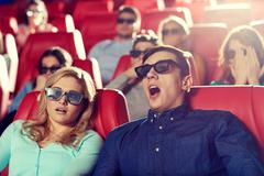 Stock Photo of friends watching horror movie in 3d theater