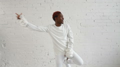 An insane black man in his forties wearing a straitjacket dance and have fun Stock Footage