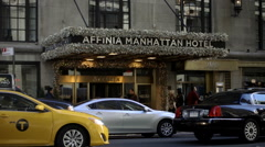 Affinia Manhattan Hotel with cars driving out front, taxi cab pulling up, NYC Stock Footage