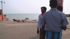 Pan WS of people on an embankment in Rameswaram, India Stock Footage