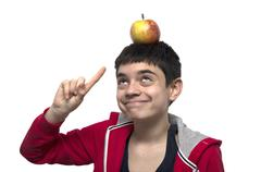 Boy with apple on the head - stock photo