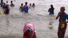Pan MS of people on an embankment in Rameswaram, India Stock Footage
