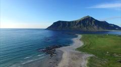 Flying over picturesque village Flakstad on Lofoten Stock Footage