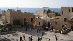 Group of tourists walk around old Jaffa, Mediterranean sea, Tel-Aviv, Israel Stock Footage