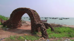 Zoom WS of a stone arch on the coast in  Rameswaram, India Stock Footage