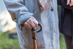 Senior woman with a walking stick Stock Photos