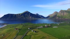 Flying over green countryside on Lofoten islands Stock Footage