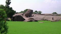 Zoom WS of  people near Krishna's Butter Ball in  Mamallapuram, India - stock footage