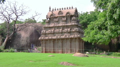 Pan WS of an ancient building and park in Mamallapuram, India - stock footage