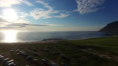 Flying over campsite and picturesque village Flakstad on Lofoten Stock Footage